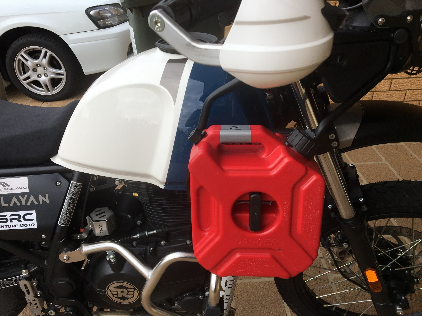 A picture containing motorcycle, black Description automatically generated